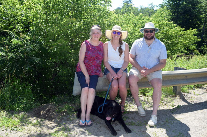 From left: Marion Mundy, Sarah Evans, and Ted Cooke attend the Whitefield Fourth of July parade for the first time with their English Lab, Odin. (Jessica Clifford photo)