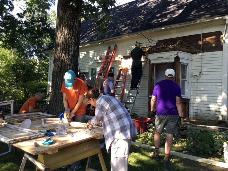 A 2017 Community Cares Day work crew repairs a house built in the 1800s.