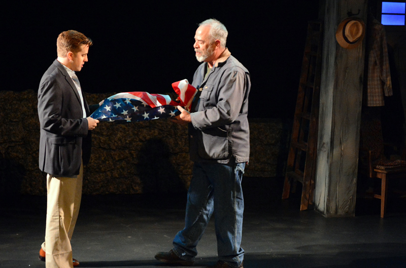 "Michael Covel (left) and Peter Henderson fold the flag in ""Independence Day,"" one of 14 vignettes in Heartwood Regional Theater Company's ""Down Along the Cove."" (Photo courtesy Jenny Mayher)"