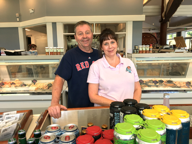 Russ and Cathy Pinkham at the oyster bar of their new store in Boothbay Harbor, Pinkham's Gourmet Market. (Suzi Thayer photo)