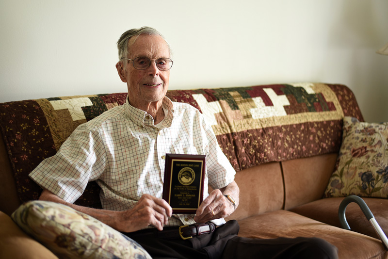 Harry Emmons, 101, holds a plaque recognizing him as Damariscotta's eldest resident in his apartment at Schooner Cove on Monday, July 30. (Jessica Picard photo)