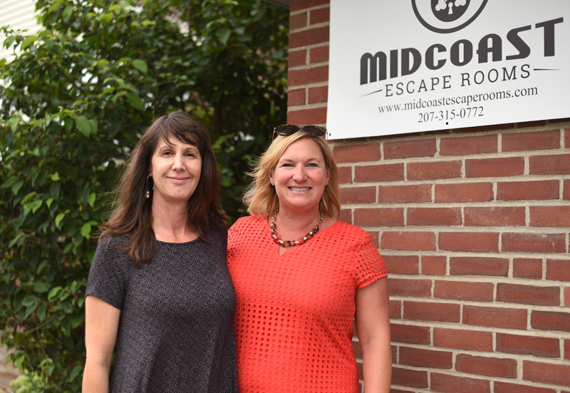 Martha Manchester (left) and Bronwen Hanna stand in front of their new business, Midcoast Escape Rooms, Monday, Aug. 13. (Jessica Picard photo)