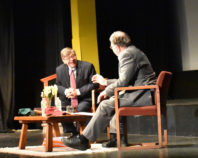 From left: Charles E. Cook Jr., editor and publisher of The Cook Political Report, speaks with Don Carrigan, a reporter with News Center Maine, at the Lincoln Theater in Damariscotta on Thursday, July 26. (Alexander Violo photo)