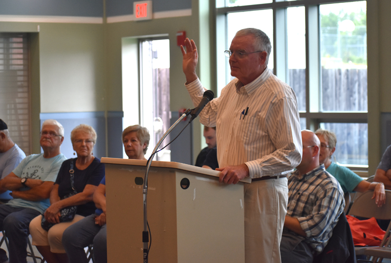 Tom Prouty is sworn in during the Dyer Long Pond water-level hearing at Jefferson Village School on Thursday, July 26. Prouty served as the representative for the petitioners. (Alexander Violo photo)