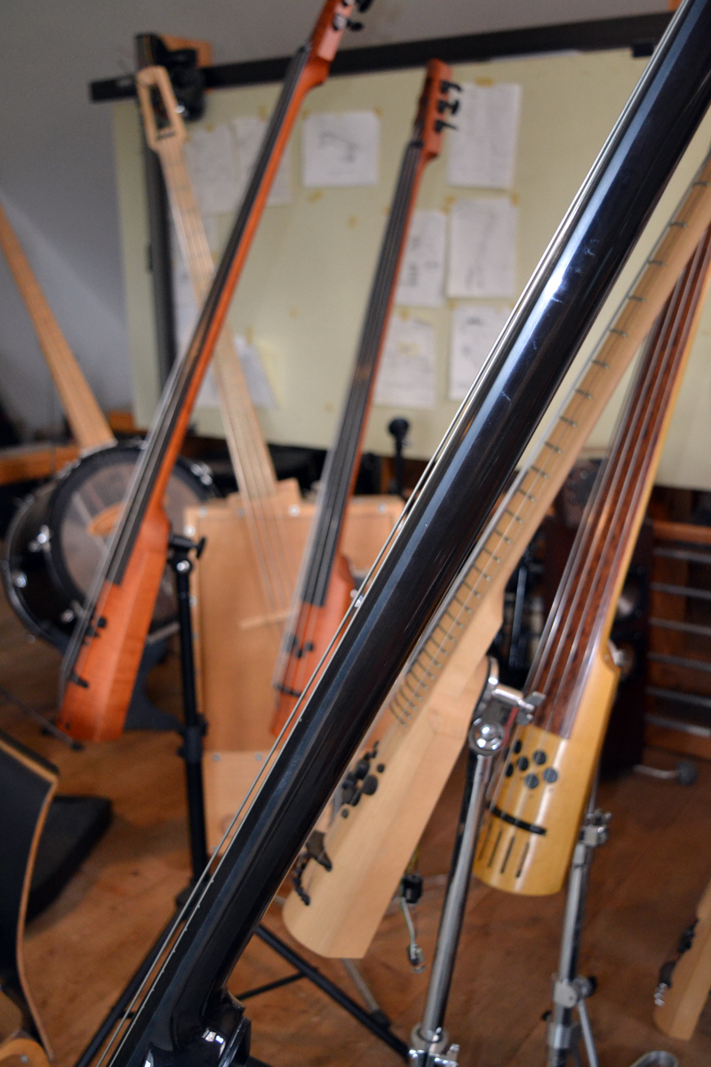 A profusion of basses in the loft area above Ned Steinberger's Nobleboro workshop. (Christine LaPado-Breglia photo)