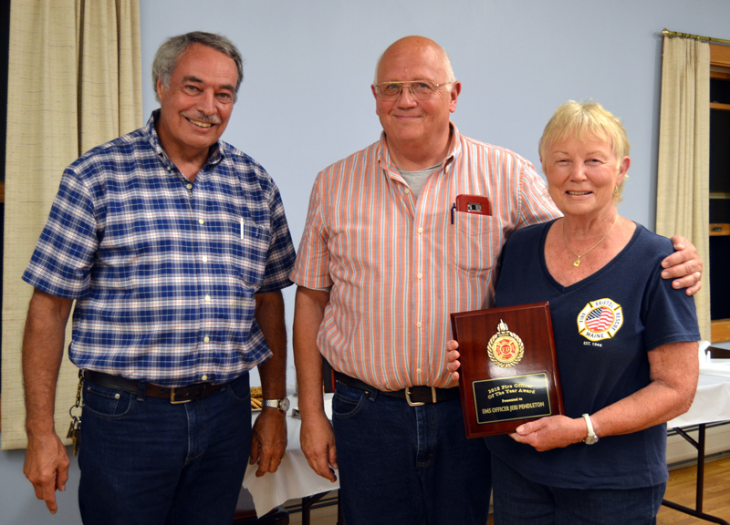 From left: Lincoln County Fire Chiefs Association Vice President Roger Whitney and Bristol Fire Chief Paul Leeman Jr. present the association's Officer of the Year Award to Jeri Pendleton, longtime leader of the Bristol First Responders.