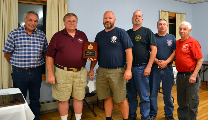 The Lincoln County Fire Chiefs Association presents its Fire Department of the Year Award to Jefferson Fire and Rescue. From left: association Vice President Roger Whitney, association President and Jefferson Fire Chief Walter Morris, Deputy Chief Darin Walker, Lt. Jeff Stone, Lt. Paul Huber, and Safety Officer Donald Hastings.