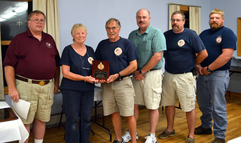 Lincoln County Fire Chiefs Association President Walter Morris (far left) presents the President's Award to the Pendleton family: Jeri, Ron, Scott, Jared, and Brad.