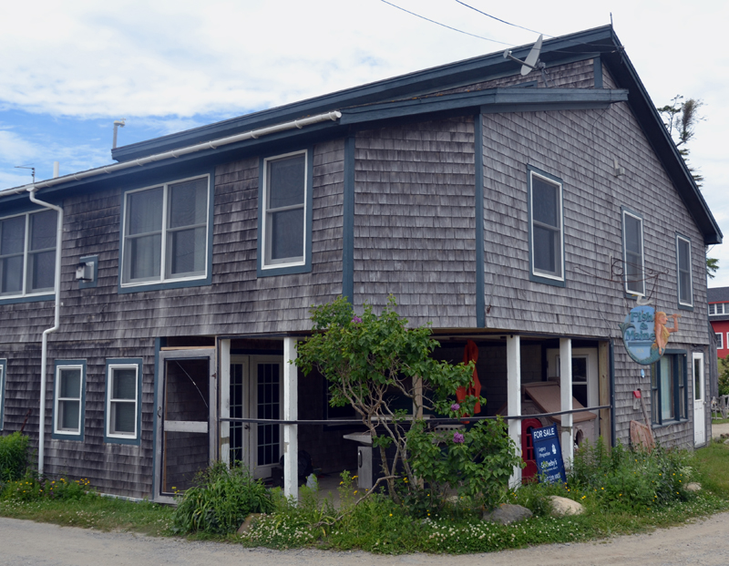 The exterior of the Fish & Maine building, at 225 Monhegan Ave. on Monhegan Island. Both La Nef Chocolate and Monhegan Coffee Roasters are on the first floor. (Maia Zewert photo)