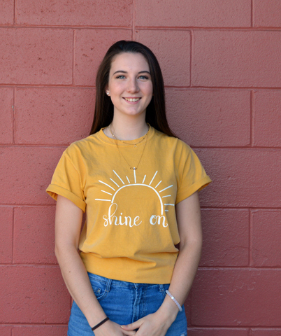 Margaret Skiff, founder of the Sunrise Clothing Co. online store, models one of her T-shirts. (Johanna Neeson photo)