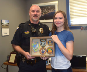 Sgt. Craig Worster receives a gift from incoming Wiscasset Middle High School freshman Alyssa Small. The student made the gift to thank Worster for helping her when she was being bullied. (Jessica Clifford photo)