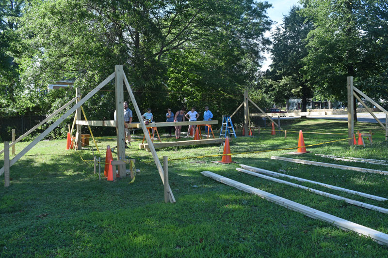 Volunteers work on a pavilion-style outdoor classroom at Wiscasset Elementary School. (Jessica Clifford photo)