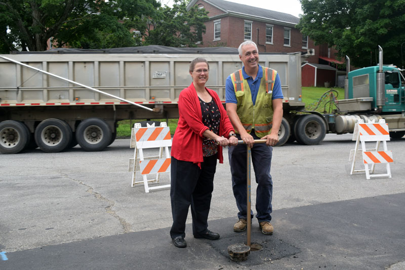 Lincoln County Administrator Carrie Kipfer and Wiscasset Water District Superintendent Chris Cossette pose for a photo during a valve-turning ceremony for the district's infrastructure project Monday, Aug. 13. (Jessica Clifford photo)