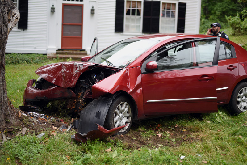 The scene of a car crash involving a Nissan Sentra on Bristol Road in Damariscotta, Tuesday, Sept. 25. Police said the Sentra struck another car, then went off the road and struck a tree in the area of 199 Bristol Road. (Jessica Picard photo)