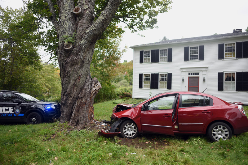 A Nissan Sentra struck another car, then left the road and struck a large tree on Bristol Road in Damariscotta, Tuesday, Sept. 25. (Jessica Picard photo)