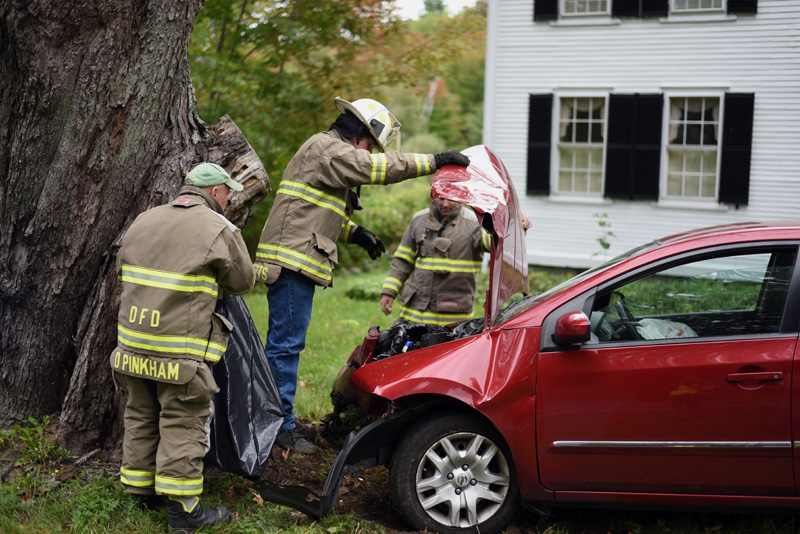 Damariscotta firefighters examine a Nissan Sentra after a collision on Bristol Road in Damariscotta, Tuesday, Sept. 25. (Jessica Picard photo)