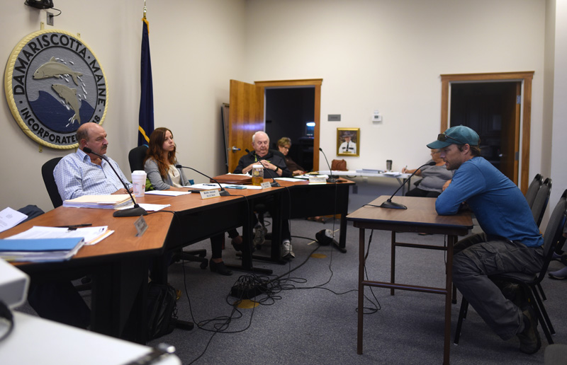 The Damariscotta Board of Selectmen listens to Tom Young-Bayer, of Newcastle, during a public hearing on a single-use plastics ordinance Wednesday, Sept. 19. (Jessica Picard photo)