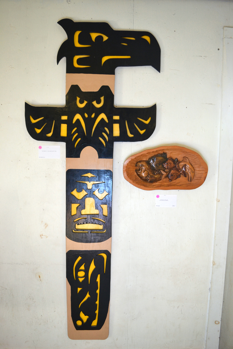 """C. Thomas Sweet's """"Totem Silhouette"""" hangs alongside his carving called """"Fish Pile"""" in his current exhibit at Sheepscot General in Whitefield. (Christine LaPado-Breglia photo)"""