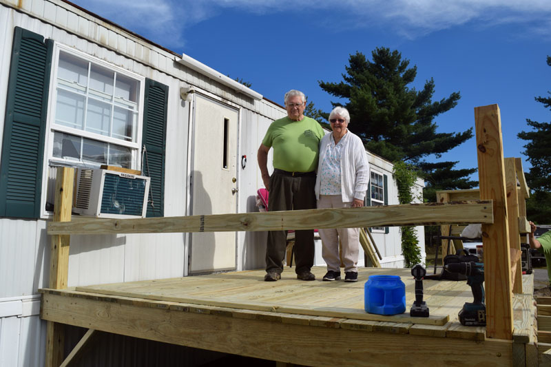 Anna and Rex Bickford, of Waldoboro, stand on the new deck of their Waldoboro home Saturday, Sept. 8. Volunteers built the deck and a ramp on CHIP Inc.'s Community Cares Day. (Jessica Clifford photo)