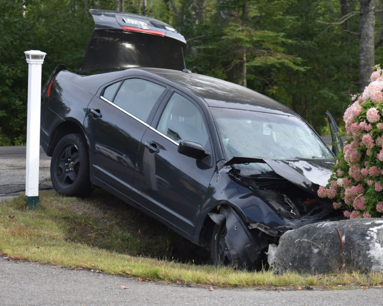 A Ford sedan was one of three vehicles involved in a collision in Waldoboro that sent four people to the hospital on the afternoon of Wednesday, Sept. 12. (Alexander Violo photo)