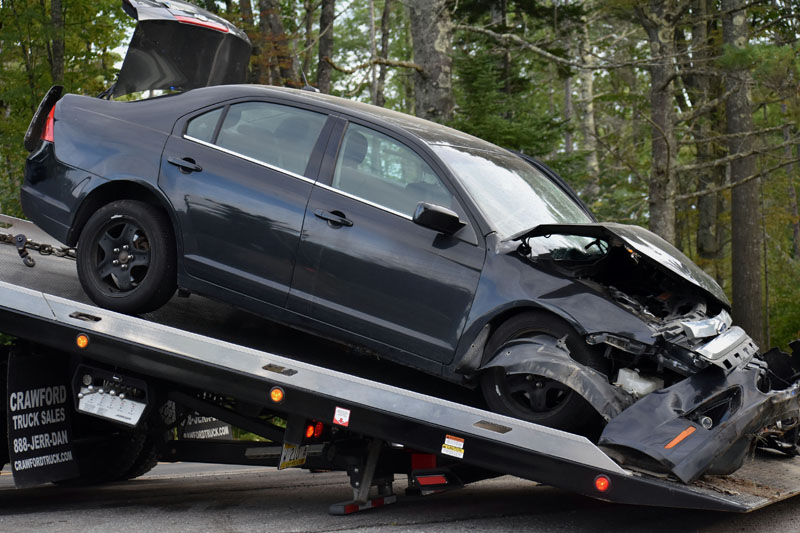 A Ford sedan is removed from the scene of a three-vehicle collision on Route 1 in Waldoboro on Wednesday, Sept. 12. (Alexander Violo photo)