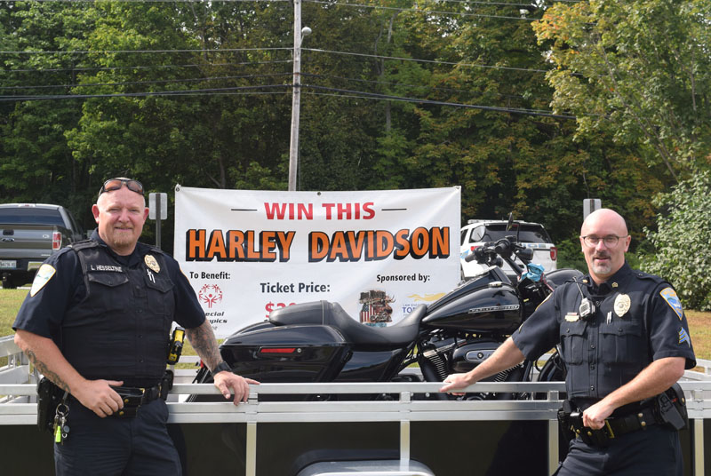 Wiscasset Police Chief Larry Hesseltine (left) and Sgt. Craig Worster stand in front of a Harley-Davidson motorcycle, the prize in an ongoing raffle to benefit Special Olympics Maine. The Wiscasset Police Department is selling raffle tickets during office hours, an example of how Hesseltine wants the department to be more active in the community. (Jessica Clifford photo)