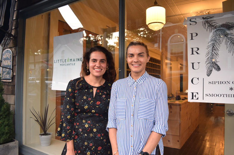From left: Sarah Castro, owner of Little Maine Mercantile, and Julie Ambrosino, owner of Spruce, in front of their storefront at 49 Water St. in Wiscasset. Both businesses will open in mid-September. (Jessica Clifford photo)
