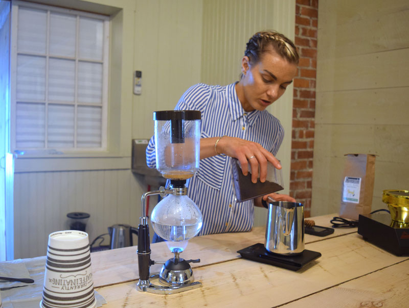 Julie Ambrosino, owner of Spruce, demonstrates how to make siphon coffee. (Jessica Clifford photo)