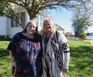 Carolyn Mattern (left) and Liz Michaud stand in front of what was once their great-grandparents' home in Round Pond on Oct. 5. (Jessica Picard photo)