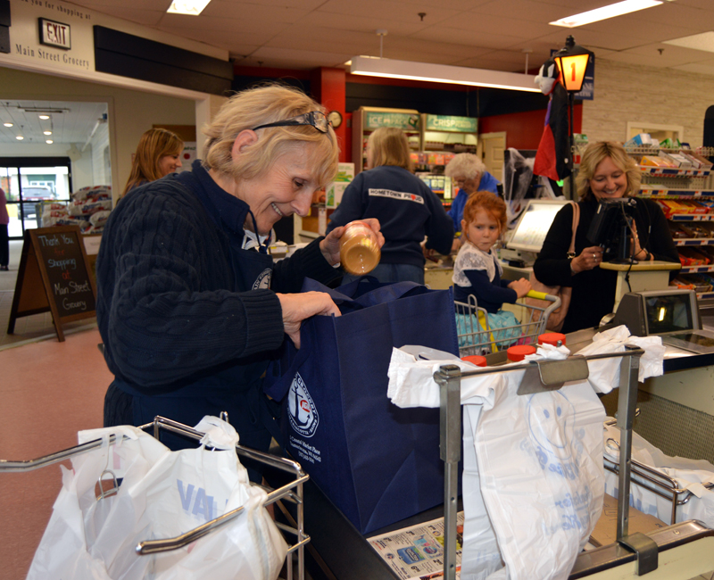 Carol Simmons places a jar of peanut butter in a reusable bag at Main Street Grocery in Damariscotta on Friday, Oct. 12. The store is introducing a new program to encourage the use of alternatives to plastic bags.