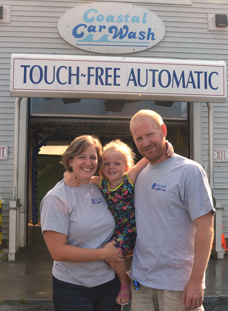 Coastal Car Wash and Detail Center owners Terri and Darick Herald with their daughter, Charlotte. The business, at 369 Main St. in Damariscotta, is celebrating its 25th anniversary this month. (Maia Zewert photo)