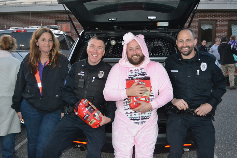 From left: Damariscotta Police Department Administrative Assistant Joanna Kenefick, Sgt. Erick Halpin, Chief Jason Warlick, and Officer David Bellows attend the Damariscotta Trunk-or-Treat at Great Salt Bay Community School on Oct. 31, 2017. (Maia Zewert photo, LCN file)