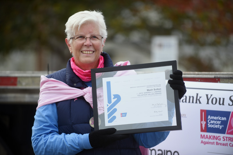 Breast cancer survivor Mash Sutton, of Damariscotta and Florida, holds the Sandra C. Labaree Volunteer Values Award, which she received during the Making Strides Against Breast Cancer event Sunday, Oct. 21. (Jessica Picard photo)