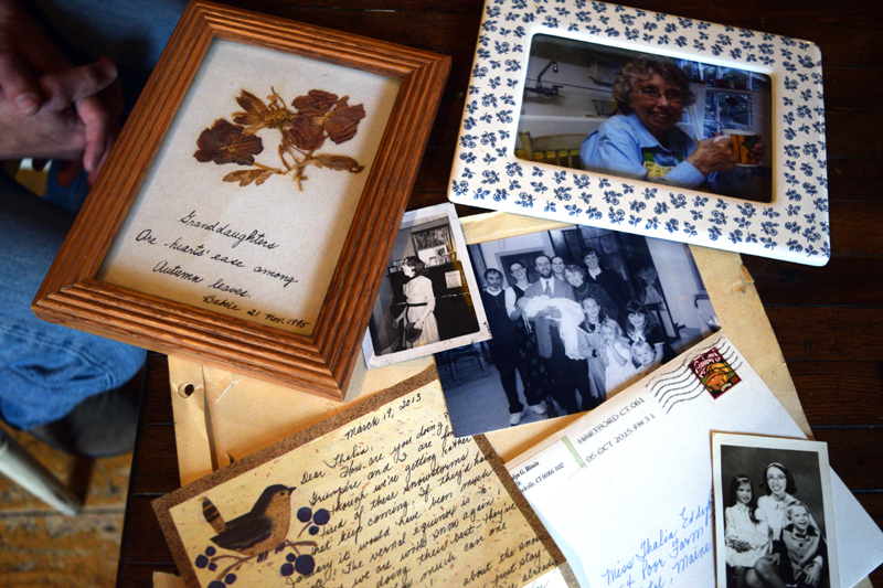 Family photos of Carolyn Blouin, with a gift and a postcard from Blouin, at her son and daughter-in-law's home in Bristol. (Jessica Clifford photo)