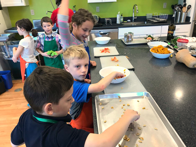 Students from Mary Hanna's second grade class at Great Salt Bay Community School learn about Native American food at the FARMS Kitchen at the Central Lincoln County YMCA.