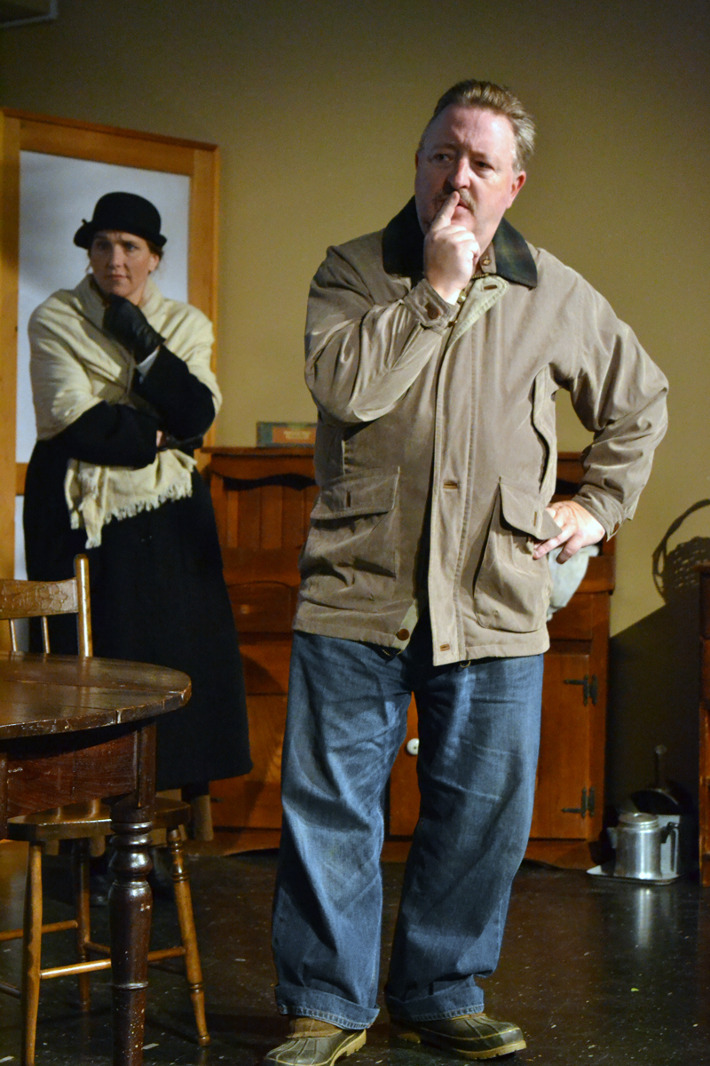 "Heather Richard, as Mrs. Hale, and Mitchell Wellman, as Mr. Hale, ponder the mysterious situation at hand in the one-act play ""Trifles,"" presented by River Company. (Christine LaPado-Breglia photo)"