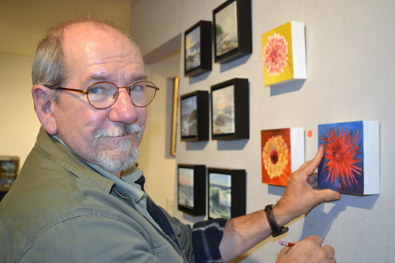 "Will Kefauver, who heads up Kefauver Studio & Gallery in Damariscotta, hangs pieces in the new ""6 x 6"" show on Thursday, Oct. 11. (Christine LaPado-Breglia photo)"