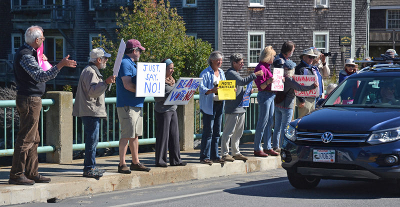 Members of Lincoln County Indivisible rally in opposition to President Donald Trump's nomination of Brett Kavanaugh to the Supreme Court. (Maia Zewert photo)