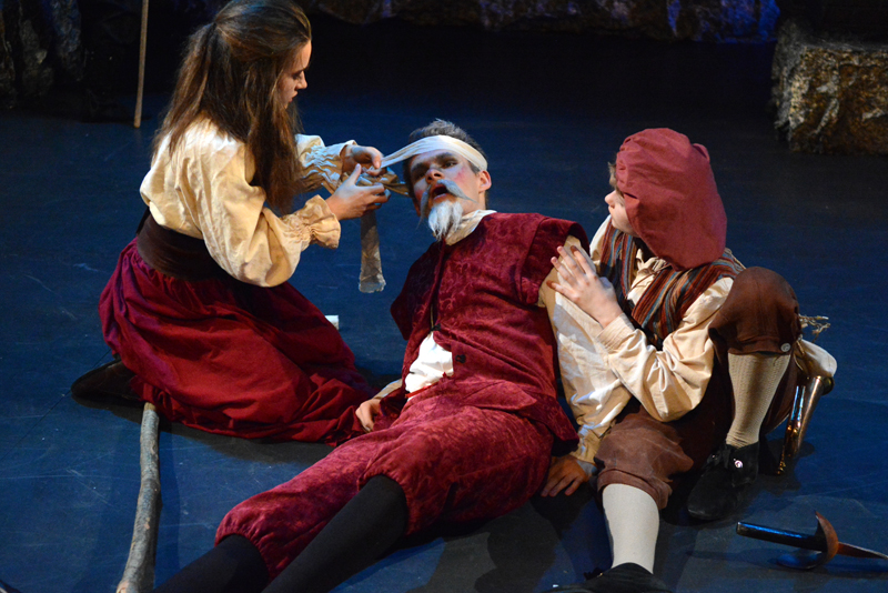 Aldonza (May Halm) tends to Don Quixote (Jonah Daiute) while Sancho Panza (Andrew Lyndaker) looks on. (Photo courtesy Jenny Mayher)