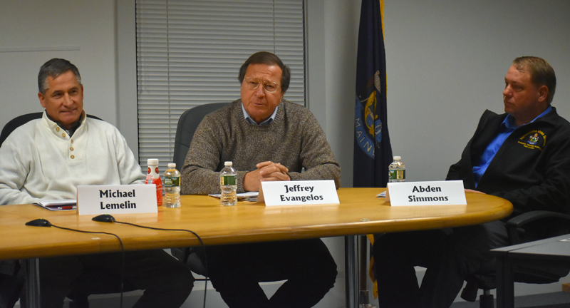 Jeffrey Evangelos (center) fields a question about campaign tactics as Michael Lemelin (left) and Rep. Abden Simmons look on. (Alexander Violo photo)