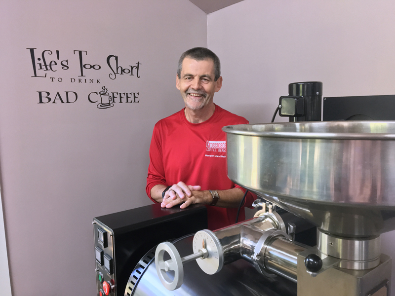 "Steve Arsenault at his coffee-roasting business, Crossroads Coffee Beans, on Westport Island. The writing on the wall says ""Life's too short to drink bad coffee."" (Suzi Thayer photo)"