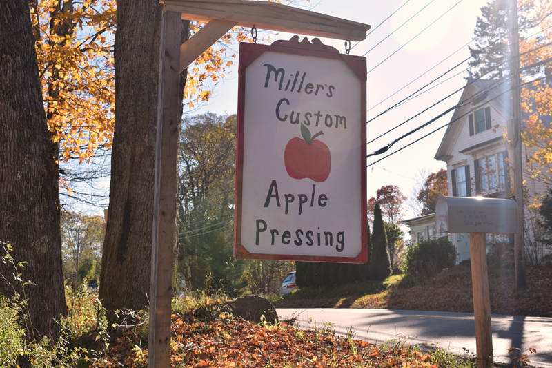 The sign for Miller's Custom Apple Pressing on Route 218, next to the North Whitefield Superette. (Jessica Clifford photo)
