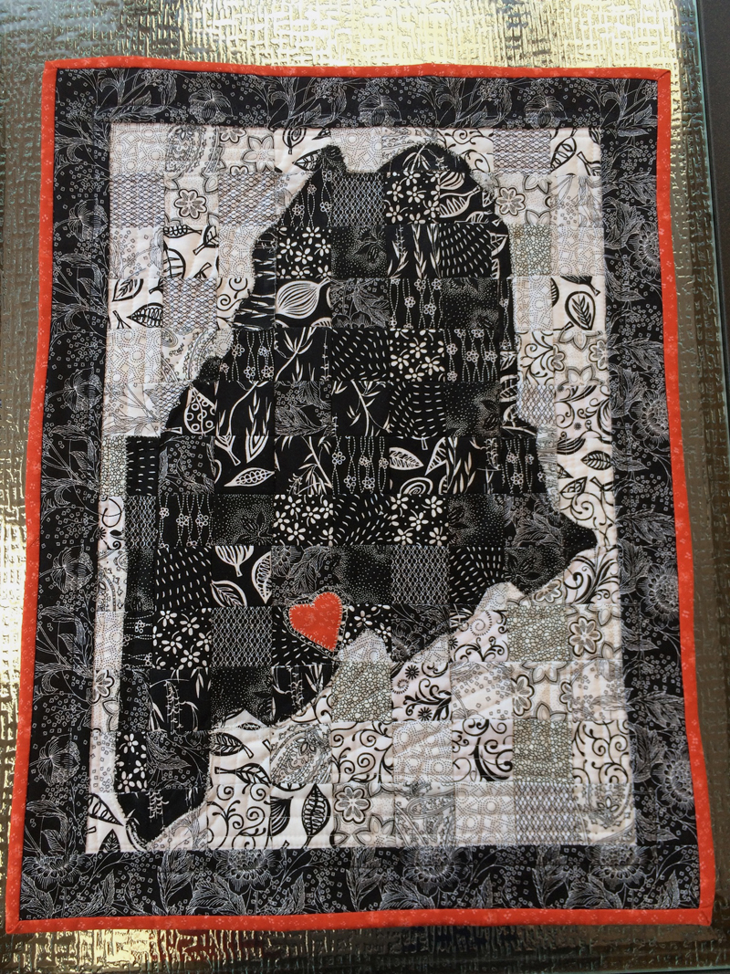 """This map-of-Maine quilt is called """"Home is Where My Heart Is"""" and was made by Beth Ditkoff."""