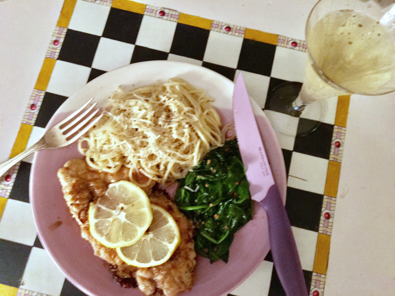 Chicken frances with sauteed spinach and cacio a pepe, and a glass of prosecco, made for a sublime meal. (Suzi Thayer photo)