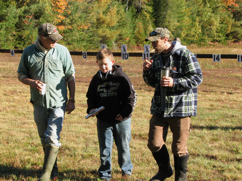 From left: David, Landon, and Derek Hanna walk back from retrieving targets.