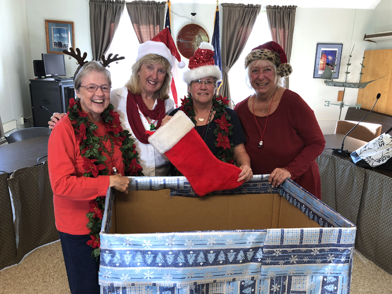 From left: Wiscasset community members Nancy Roby, Terri Wells, Judy Flanagan, and Terry Hellerbegin work on providing help to parents in providing the needs and wishes of local children during this holiday season by promoting the Annual Spirit of Giving program. (Photo courtesy Kathy Onorato, Town of Wiscasset)