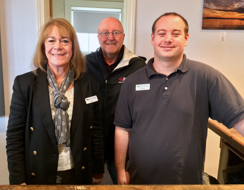 From left: desk clerk Lin Koch, co-owner Tony Krason, and office manager Nate Stanley at the front desk of the Ocean Point Inn. (Suzi Thayer photo)