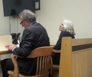 Portland attorney Richard Berne sits next to Nancie Atwell during a sentence hearing at the Lincoln County Courthouse in Wiscasset on Monday, Nov. 26. Atwell, a prominent local author and educator, will avoid jail time for a series of shoplifting incidents. (Jessica Clifford photo)