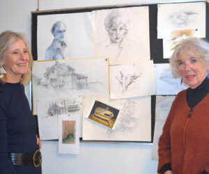 From left: Kathy Leeman, vice president of Legacy Properties Sotheby's International Realty, chats with artist Marlene Loznicka about her early drawings at the opening reception for Loznicka's retrospective show Saturday, Nov. 24. (Christine LaPado-Breglia photo)
