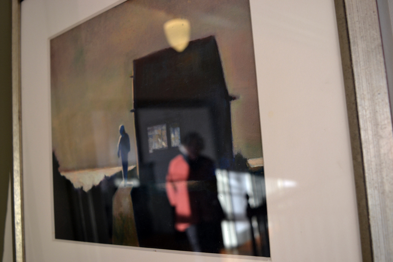 "Marlene Loznicka is reflected in the glass covering her giclee piece ""Manana."" (Christine LaPado-Breglia photo)"